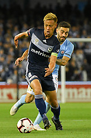Melbourne, October 20, 2018 - Keisuke Honda of Melbourne Victory controls the ball in the round one match of the A-League between Melbourne Victory and Melbourne City at Marvel Stadium, Melbourne, Australia. Photo Sydney Low