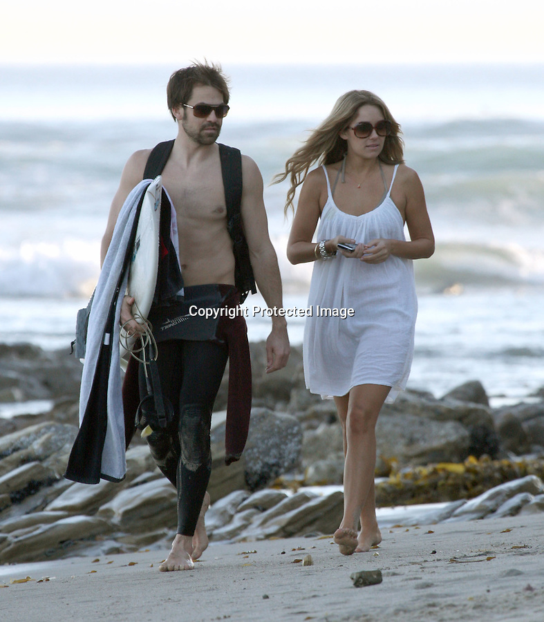 1-20-09  Exclusive.Lauren Conrad walking on the beach in Malibu California with boyfriend Kyle Howard. Lauren watched her boyfriend surf for about an hour then fell asleep for another hour.....AbilityFilms@yahoo.com.805-427-3519.www.AbilityFilms.com.