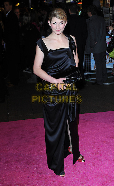 "JODIE WHITTAKER.The UK Film Premiere of ""St. Trinian's 2: The Legend Of Fritton's Gold"" at Empire Leicester Square, London, England..December 9th 2009.Trinians St arrivals full length black dress long maxi hand on hip silk satin clutch bag red open peep toe shoes .CAP/BEL.©Tom Belcher/Capital Pictures."