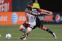 Colorado Rapids midfielder Martin Rivero (10) shields the ball from D.C. United midfielder Perry Kitchen (23)  D.C. United defeated the Colorado Rapids 2-0 at RFK Stadium, Wednesday May 16, 2012.