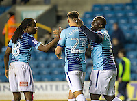 Adebayo Akinfenwa of Wycombe Wanderers (right) celebrates his goal during the Checkatrade Trophy round two Southern Section match between Millwall and Wycombe Wanderers at The Den, London, England on the 7th December 2016. Photo by Liam McAvoy.