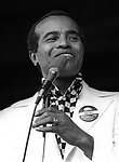 """Jon Hendricks, Sept 1974, American jazz lyricist and singer. He is considered one of the originators of vocalese, which adds lyrics to existing instrumental songs and replaces many instruments with vocalists. He is considered one of the best practitioners of scat singing, which involves vocal jazz soloing. Jazz critic and historian Leonard Feather called him the """"Poet Laureate of Jazz"""""""