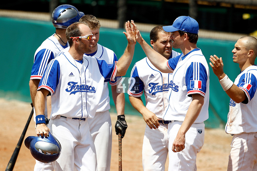 23 June 2011: Joris Bert of Team France is congratulated by his teammates during USSSA 5-3 win over France, at the 2011 Prague Baseball Week, in Prague, Czech Republic.