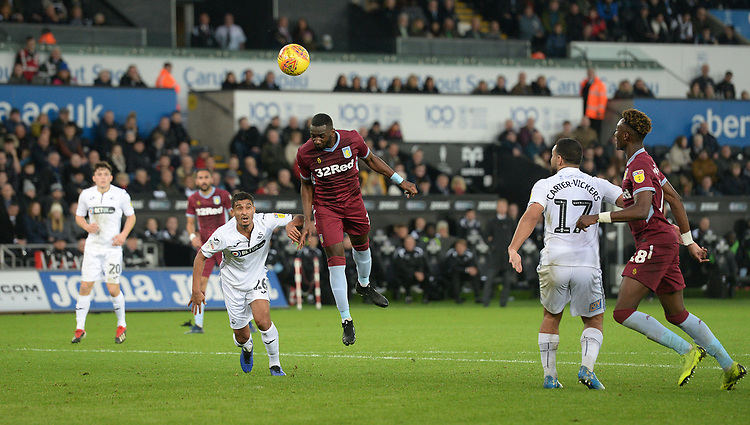 Aston Villa's Yannick Bolasie heads towards goal<br /> <br /> Photographer Ian Cook/CameraSport<br /> <br /> The EFL Sky Bet Championship - Swansea City v Aston Villa - Wednesday 26th December 2018 - Liberty Stadium - Swansea<br /> <br /> World Copyright © 2018 CameraSport. All rights reserved. 43 Linden Ave. Countesthorpe. Leicester. England. LE8 5PG - Tel: +44 (0) 116 277 4147 - admin@camerasport.com - www.camerasport.com