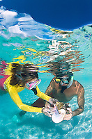 Couple with conch shell snorkeling at Buck Island<br />