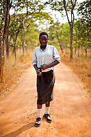 "14 year old Grace Bwalya from Chalilo school in Sereje district, on her first safari in Kasanka National Park. ""I am very happy to see Puku [antelope] for the first time and liked the arrangement of the teeth of the elephant - it is the first time I have seen that. I put my hand in the bit where the tusks were! I will tell my parents not to buy poached meat because it is the animals that bring in tourism. And the tourism sector has given a lot of jobs to a lot of people. So if poaching is allowed then there will be less jobs."" Local schools and women's groups are regularly brought into Kasanka, which is unique in the country and unusual in Africa as it is privately managed and owned by a trust. People are able to see animals flourishing in land which was once free reign for poachers. Combined with anti-poaching scouts, the education programme is on the frontline of conservation methods in the park, showing local people wild animals in their natural habitat."