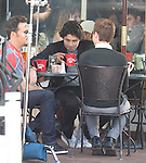 The Cast of Entourage filming at The Earth Café on Melrose in los Angeles ca .Talking on there cell phone ..6-22-09.Kevin Connolly    .Adrian Grenier .Kevin Dillon.Jerry Ferrara... AbilityFilms@yahoo.com.805-427-3519.www.AbilityFilms.com.