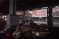 Rubbish cart and pile of rubbish. Images of New York 2005, New York,U.S.A