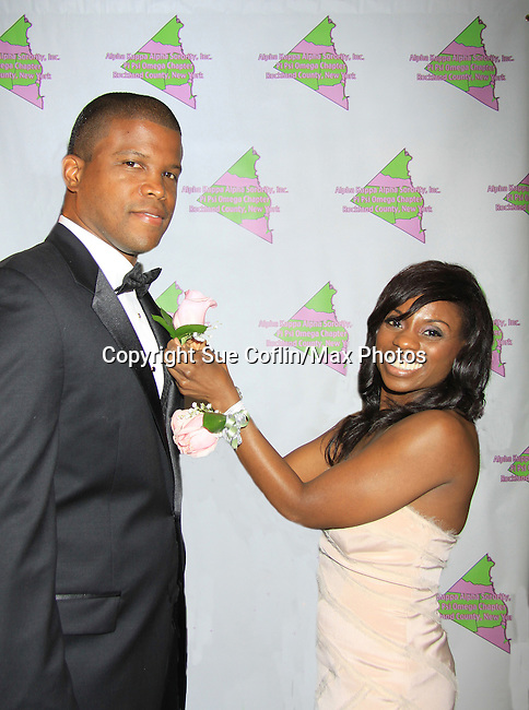 "Master of Ceremony Sharif Atkins (White  Coller ""Agent Jones"", ER ""Michael Gallant"", The Good Wife and more) gets a boutineer from Delaina Dixon - President wearing Nicole Miller - Alpha Kappa Alpha Sorority, Incorporated Pi Psi Omega Chapter welcomes you to ""A Pink Carpet Affair"" - celebrating 25 years of Sisterhood and Service on June 9, 2012 at the Comfort Inn and Suites, Nanuet, New York"