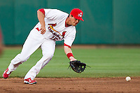 Eric Duncan (15) of the Springfield Cardinals attempts to make a play on a ground ball during a game against the Tulsa Drillers on April 29, 2011 at Hammons Field in Springfield, Missouri.  Photo By David Welker/Four Seam Images.