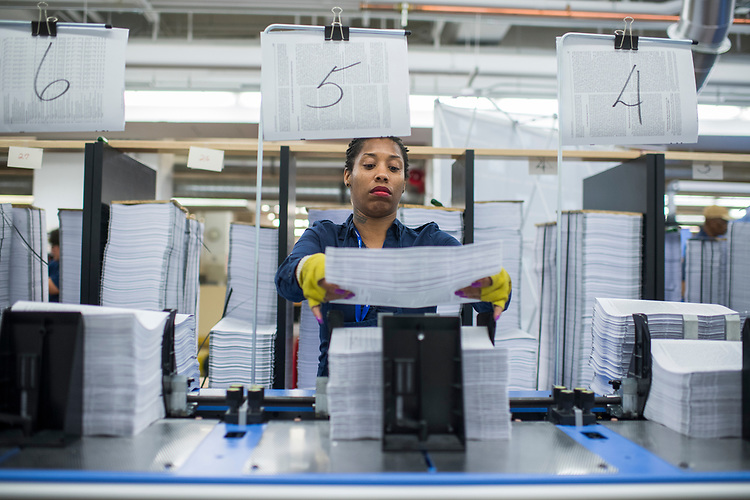 UNITED STATES - MAY 19: Christina McGrier assembles the budget for Fiscal Year 2018 at the Government Publishing Office's plant on North Capitol Street before a visit from OMB Director Mick Mulvaney and GPO Director Davita Vance-Cooks on May 19, 2017. The budget will be released next week. (Photo By Tom Williams/CQ Roll Call)