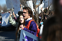 NWA Democrat-Gazette/J.T. WAMPLER Huxley Richardson joins around 300-400 fellow students as they participate in a march and rally against gun violence at the Washington County Courthouse Wednesday March 14, 2018. Fayetteville High School students also attended a rally at the school in solidarity with Stoneman Douglas High School students.