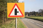Triangular road sign for right turn junction ahead, Sutton, Suffolk, England