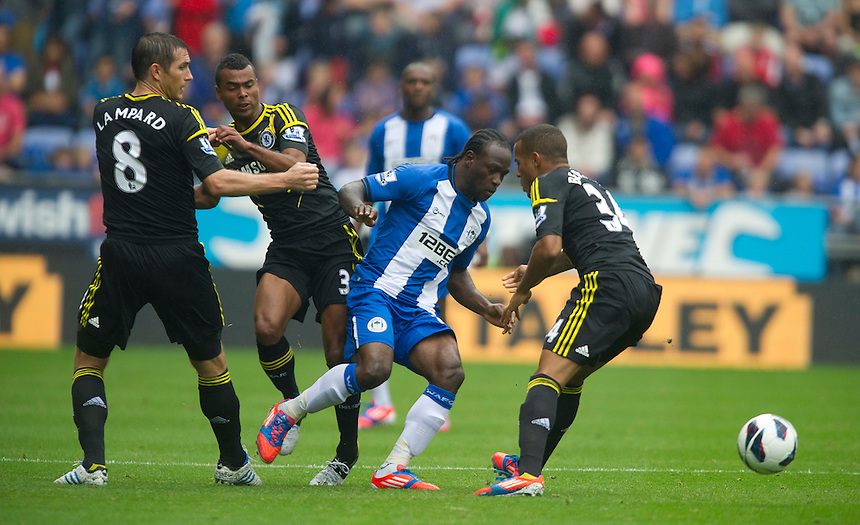 Wigan Athletic's Victor Moses battles against Chelsea's Frank Lampard, Ashley Cole and Ryan Bertrand ..Football - Barclays Premiership - Wigan Athletic v Chelsea - Sunday 19th August 2012 - DW Stadium - Wigan..