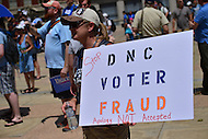 "Philadelphia, PA - July 26, 2016: A woman displays a sign denouncing a recent email scandal at the Democratic National Committee at a ""Bernie or Bust"" rally across from City Hall during the Democratic National Convention in Philadelphia, PA, July 26, 2016  (Photo by Don Baxter/Media Images International)"