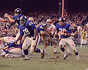 New York Giants Willie Young (69) lead blocks for Bobby Duhon (28) during a game against the San Francisco 49ers on October 20. 1968 at Yankee Stadium in the Bronx, New York.  The  San Francisco 49ers beat the New York Giants 26-10.(SportPics)
