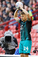 Jake Bidwell of Swansea City takes a throw in during the Sky Bet Championship match between Barnsley and Swansea City at Oakwell Stadium, Barnsley, England, UK. Saturday 19 October 2019