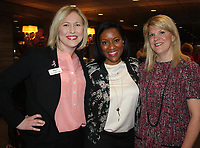 NWA Democrat-Gazette/CARIN SCHOPPMEYER Lauren Marquette, Komen Ozark executive director (from left), Latriece Watkins, 2017 Race for the Cure honorary chairwoman, and Sue Redfield, 2015 race honorary chairwomen welcome guests the the Race for the Cure Kick-off on March 1 at Crabby's in Rogers.