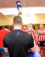 Lincoln City's Tom Pett, rights, with Lincoln City's lead sports scientist Luke Jelly celebrate after winning the league<br /> <br /> Photographer Chris Vaughan/CameraSport<br /> <br /> The EFL Sky Bet League Two - Lincoln City v Tranmere Rovers - Monday 22nd April 2019 - Sincil Bank - Lincoln<br /> <br /> World Copyright © 2019 CameraSport. All rights reserved. 43 Linden Ave. Countesthorpe. Leicester. England. LE8 5PG - Tel: +44 (0) 116 277 4147 - admin@camerasport.com - www.camerasport.com