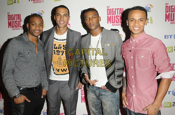 JLS - JB Gill, Marvin Humes, Oritse Williams & Aston Merrygold.BT Digital Music Awards held at the Roundhouse, Chalk Farm, London, England..September 29th 2011.half length grey gray shirt jacket white top red shirt pink.CAP/CAN.©Can Nguyen/Capital Pictures.