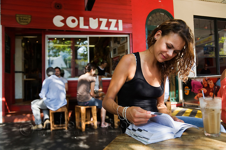 A young woman at Bar Coluzzi in Darlinghurst, Sydney, New South Wales, AUSTRALIA.