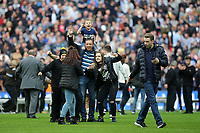 A young Millwall family invade the pitch at the final whistle and pose for a photograph during Bradford City vs Millwall, Sky Bet EFL League 1 Play-Off Final at Wembley Stadium on 20th May 2017
