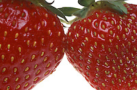 Two Strawberries. Closeup of Two Strawberries.