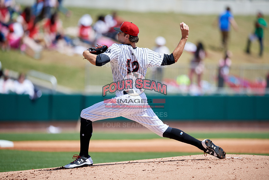 Birmingham Barons starting pitcher Spencer Adams (12) delivers a pitch during a game against the Jacksonville Jumbo Shrimp on April 24, 2017 at Regions Field in Birmingham, Alabama.  Jacksonville defeated Birmingham 4-1.  (Mike Janes/Four Seam Images)