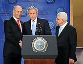 Annapolis, MD - November 27, 2007 -- Prime Minister Ehud Olmert of Israel, United States President George W. Bush, and President Mahmoud Abbas of the Palestinian Authority share a handshake after Bush read a statement at The Annapolis Conference convened at the United States Naval Academy in Annapolis, Maryland on Tuesday, November 27, 2007..Credit: Ron Sachs / CNP