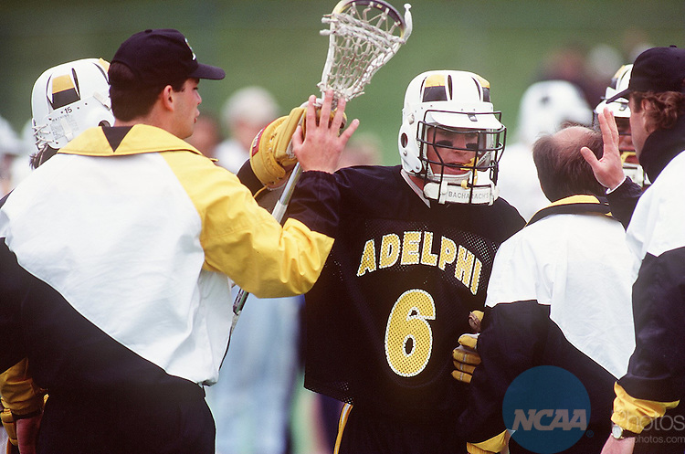 Caption: Mike DiGiacomo (#6) of Adelphi Unversity celebrates his team's win over Springfield College for the Division II Men's Lacrosse Championship March 13, 1995, in Springfield, Mass. Adelphi University defeated Springfield 12-10. Winslow Townsend/NCAA photos.
