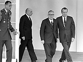 "United States President Richard M. Nixon, right, and Prime Minister Mariano Rumor of Italy, center, depart the Oval Office of the White House in Washington, DC on April 1, 1969.  Rumor was visiting the Nation's Capital for the State Funeral of former US President Dwight D. Eisenhower.  Following at left center is Ambassador of Italy to the United States Egidio Ortona.<br /> Credit: Benjamin E. ""Gene"" Forte / CNP"