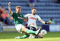 Preston North End's Tom Barkhuizen is tackled by Sheffield Wednesday's Tom Lees<br /> <br /> Photographer Rich Linley/CameraSport<br /> <br /> The EFL Championship - Preston North End v Sheffield Wednesday - Saturday August 24th 2019 - Deepdale Stadium - Preston<br /> <br /> World Copyright © 2019 CameraSport. All rights reserved. 43 Linden Ave. Countesthorpe. Leicester. England. LE8 5PG - Tel: +44 (0) 116 277 4147 - admin@camerasport.com - www.camerasport.com