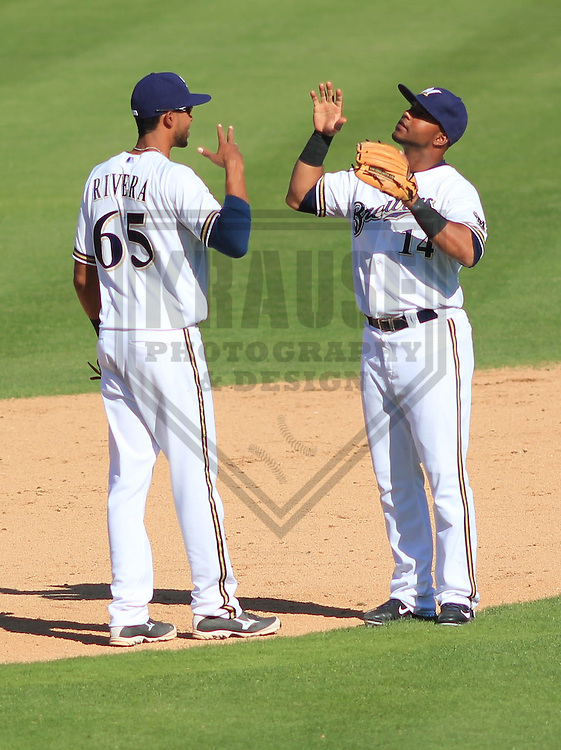 MARYVALE - March 2015: Yadiel Rivera and Luis Jimenez of the Milwaukee Brewers during a spring training game against the Seattle Mariners on March 26th, 2015 at Maryvale Baseball Park in Mesa, Arizona. (Photo Credit: Brad Krause)