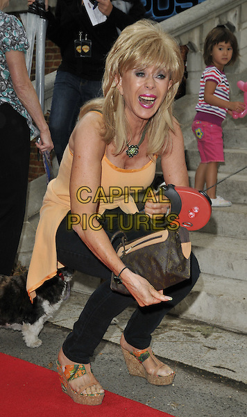 "SALLY FARMILOE.""Cats & Dogs: Revenge of Kitty Galore"" UK premiere, Holland Park Open Air Theatre, London, England..August 1st, 2010.full length animal pet orange vest top mouth open jeans denim platform sandals .CAP/CAN.©Can Nguyen/Capital Pictures."