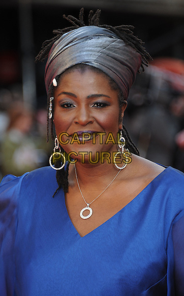 Sharon D. Clarke.The Olivier Awards 2012, Royal Opera House, Covent Garden, London, England..April 15th, 2012.headshot portrait blue grey gray turban hat earrings silver necklace  .CAP/WIZ.© Wizard/Capital Pictures.