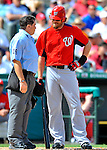 3 March 2011: Washington Nationals' outfielder Jayson Werth chats with Home Plate Umpire Ed Rapuano during a Spring Training game against the St. Louis Cardinals at Roger Dean Stadium in Jupiter, Florida. The Cardinals defeated the Nationals 7-5 in Grapefruit League action. Mandatory Credit: Ed Wolfstein Photo