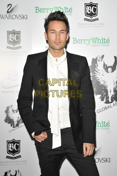 A Guest.'Global Angels Awards', The Park Plaza Hotel, Westminster, London, England. 2nd December 2011..half length black jacket white shirt .CAP/MAR.© Martin Harris/Capital Pictures.