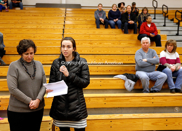 Torrington, CT- 05 March 2015-030515CM01- Erin Considine, a second grade teacher at Forbes School talks about Jorge Soto, a Forbes School Custodian who passed away on March 4th, before the start of a basketball game at Torrington High School on Thursday.  With Considine is Robin Ledversis, who worked at Forbes School.   Christopher Massa Republican-American