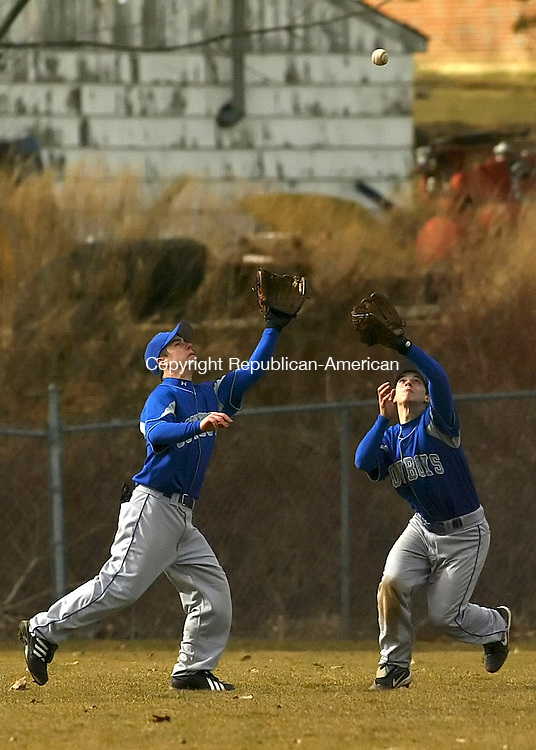 WINSTED, CT 4/13/07- 041307BZ12- Litchfield's Michael Leavitt (11), left, and teammate Ernest Nalband (4) run in to make a catch against Northwestern Friday afternoon. Leavitt made the catch after colliding with Nalband.<br /> Jamison C. Bazinet Republican-American