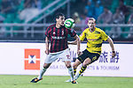 AC Milan Defender Gustavo Gomez (L) plays against Borussia Dortmund Midfielder Andre Schurrle (R) in action during the International Champions Cup 2017 match between AC Milan vs Borussia Dortmund at University Town Sports Centre Stadium on July 18, 2017 in Guangzhou, China. Photo by Marcio Rodrigo Machado / Power Sport Images