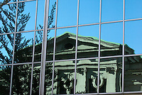 Reflection of the Vancouver Art Gallery in a glass building, Vancouver, British Columbia, Canada. This was formerly the Provincial Courthouse.