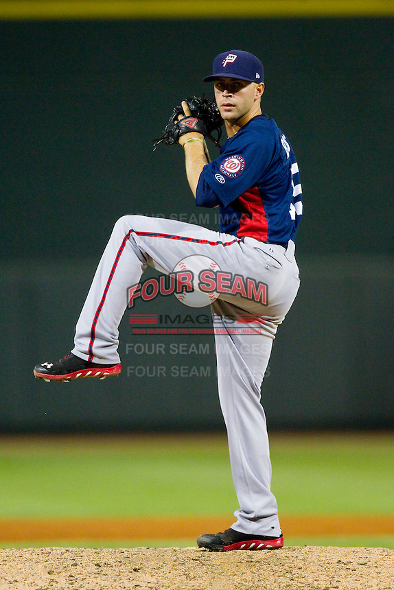 Potomac Nationals relief pitcher Colin Bates (19) delivers a pitch to the plate against the Winston-Salem Dash at BB&T Ballpark on July 8, 2013 in Winston-Salem, North Carolina.  The Dash defeated the Nationals 12-9.  (Brian Westerholt/Four Seam Images)