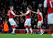 14th September 2017, Emirates Stadium, London, England; UEFA Europa League Group stage, Arsenal versus FC Cologne; Sead Kolasinac of Arsenal celebrates levelling the score in the 49th minute with Per Mertesacker and Hector Bellerin, 1-1