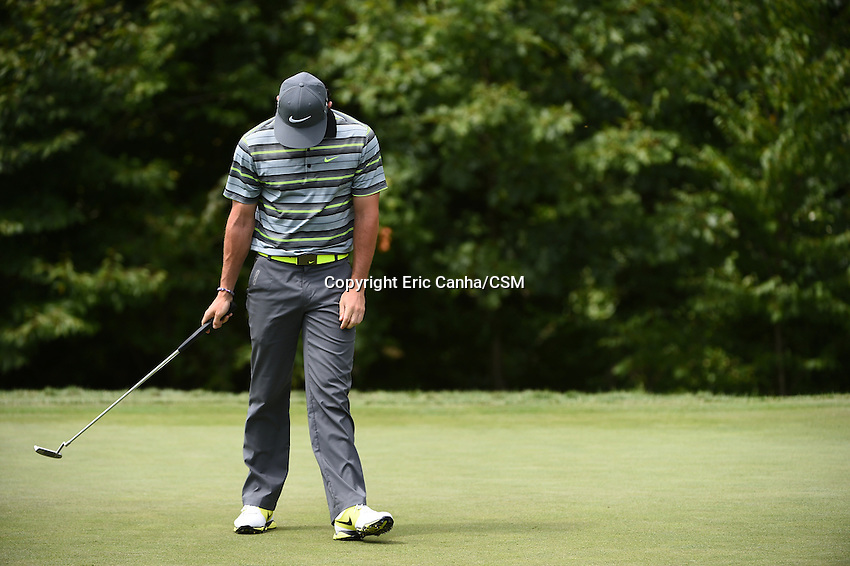 August 29, 2014 -  Norton, Mass. - Rory McIlroy hangs his head after putting on the 5th green during the first round of the PGA Deutsche Bank Championship held at the Tournament Players Club in Norton Massachusetts. McIlroy bogied the hole ending tied for 26th,  shooting -1 70 for the round.  Eric Canha/CSM