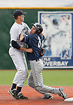 March 30, 2012:   BYU Cougars baserunner Tanner Chauncey collides with Nevada Wolf Pack shortstop Garrett Yrigoyen during their NCAA baseball game played at Peccole Park on Friday afternoon in Reno, Nevada.