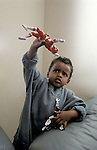 Albany CA Boy, four-years-old, in fantasy play with superhero doll