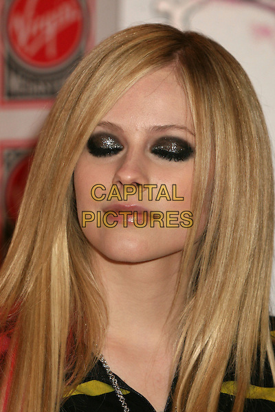 "AVRIL LAVIGNE.Avril Lavigne ""The Best Damn Thing"" CD Signing at the Virgin Megastore, Hollywood, California, USA..Byron Purvis/AdMedia .April 19th, 2007.headshot portrait eyeliner make-up make up make-up eyes closed glitter eyeshadow.CAP/ADM/BP.©Byron Purvis/AdMedia/Capital Pictures"