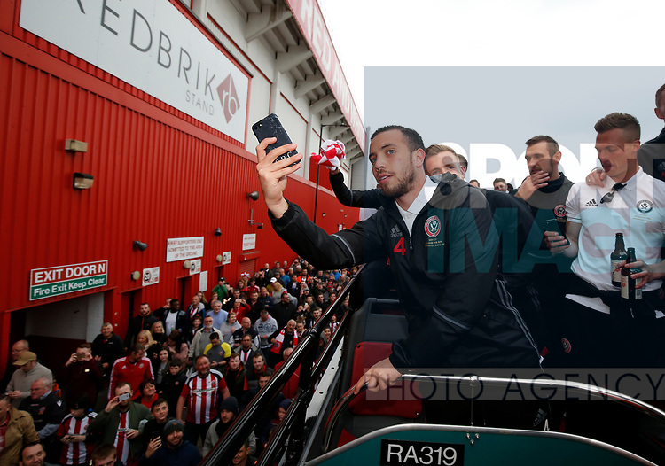 Samir Carruthers of Sheffield Utd films the following fans during the open top bus parade from Bramall Lane Stadium to Sheffield Town Hall, Sheffield. Picture date: May 2nd 2017. Pic credit should read: Simon Bellis/Sportimage