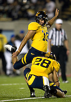 Vincenzo D'Amato of California kicks the ball during PAT against UCLA at Memorial Stadium in Berkeley, California on October 6th, 2012.  California defeated UCLA, 43-17.
