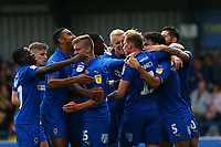 The Wimbledon team celebrate their third goalscorer by Mitch Pinnock  during AFC Wimbledon vs Rochdale, Sky Bet EFL League 1 Football at the Cherry Red Records Stadium on 5th October 2019
